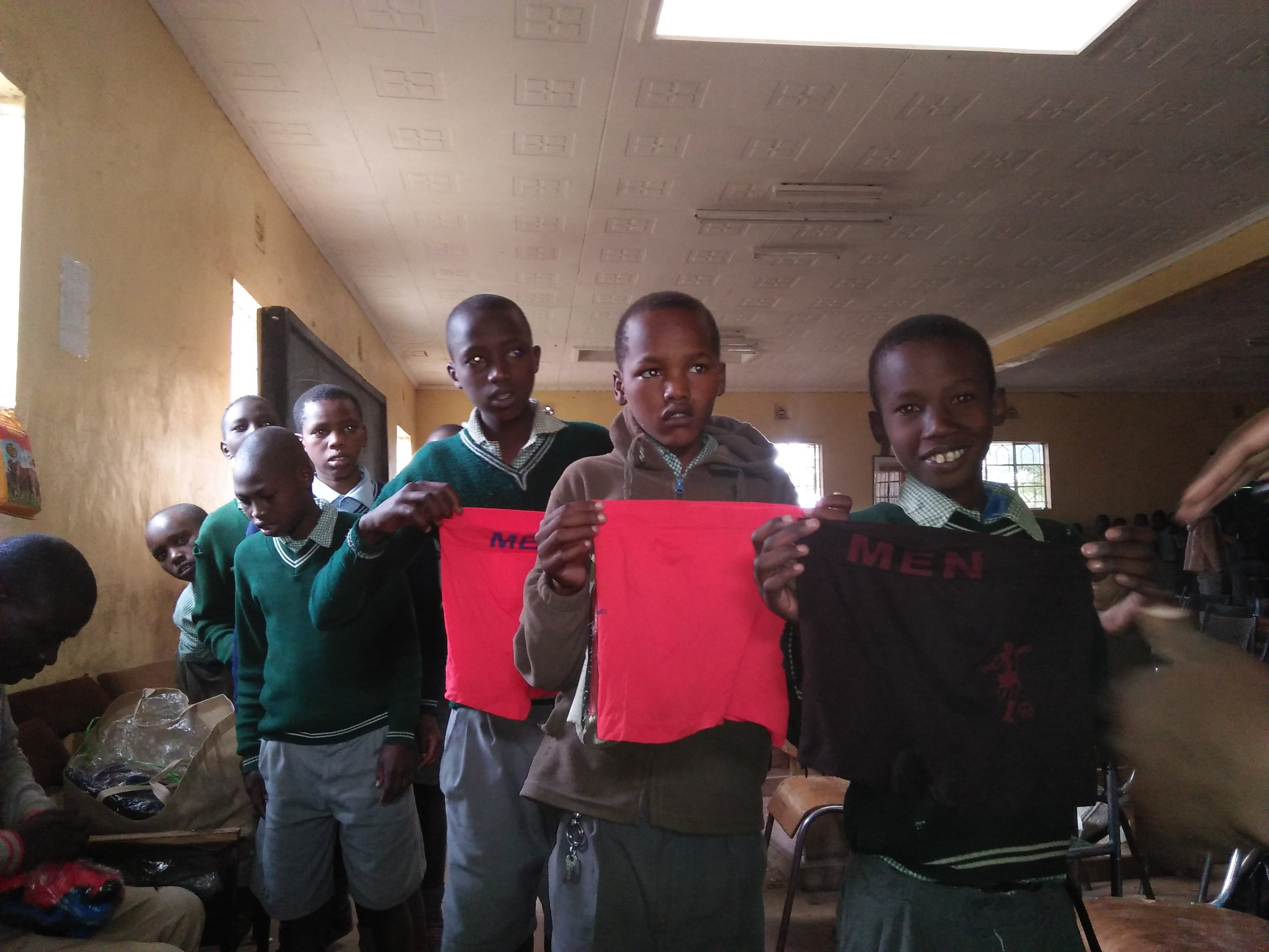Standing With Boys donating underwear