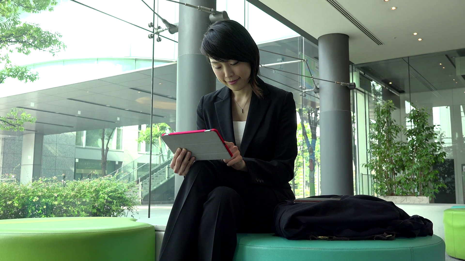 business-travel-people-working-in-hotel-lobby-office-building-japanese-female-manager-asian-businesswoman-girl-woman-at-work-using-ipad-digital-tablet-pc-computer-for-email-internet_s8kv6j38x_thumbnail-full01.png