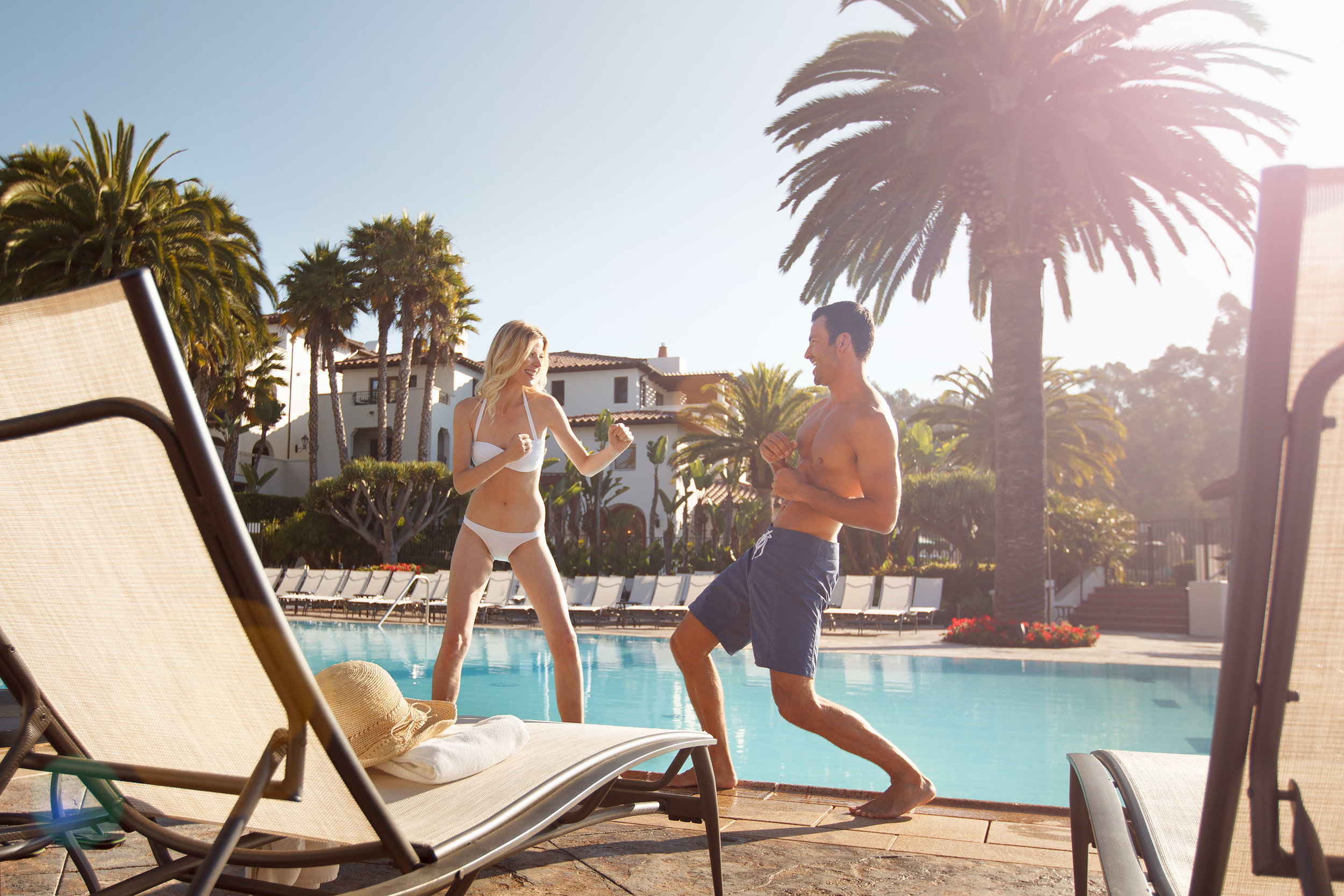 Lifestyle-007-luxury-resort-pool-couple.jpg