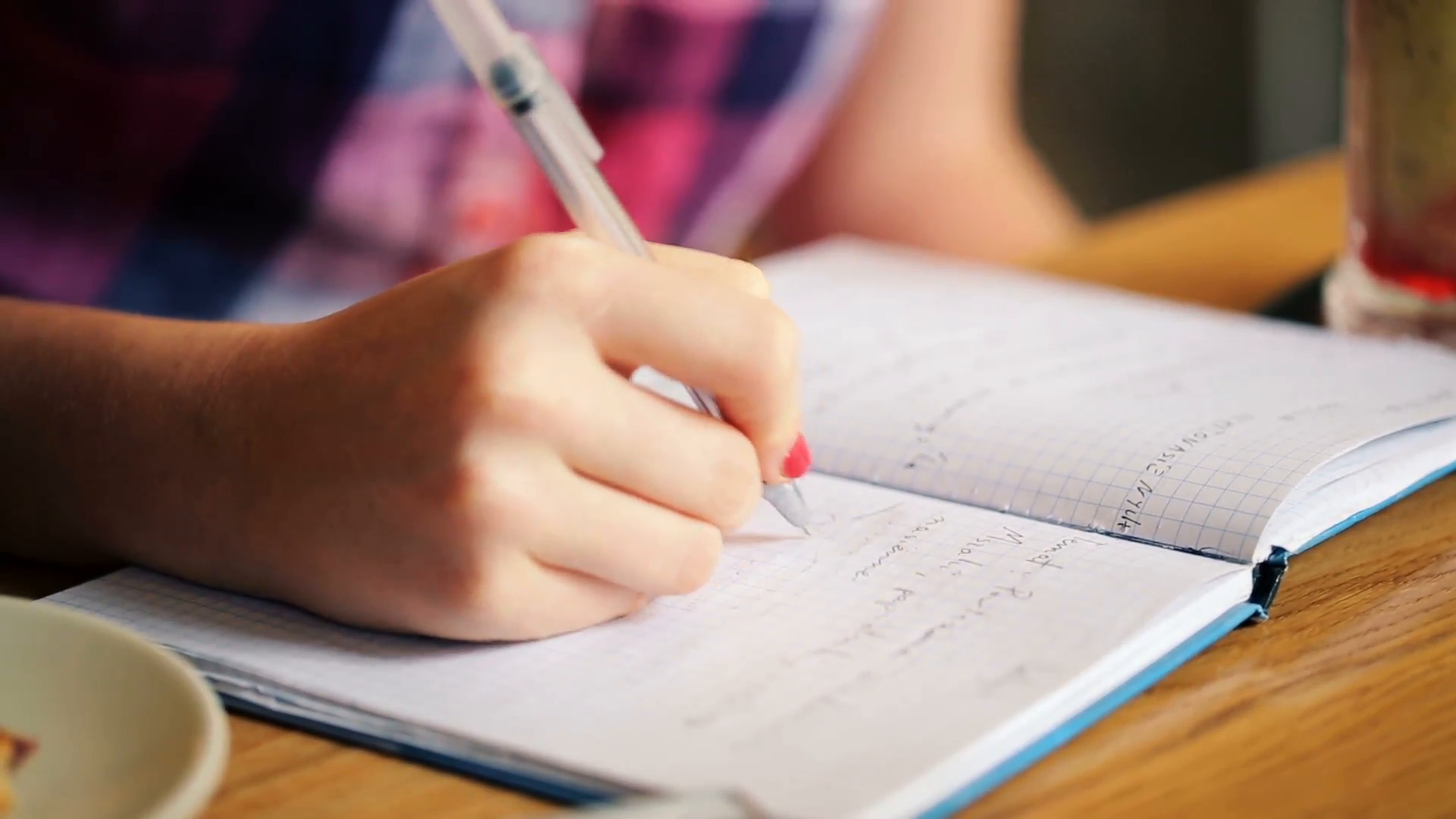 teenage-girl-hands-writing-in-notebook-doing-homework_vyfyytly__F0000.png