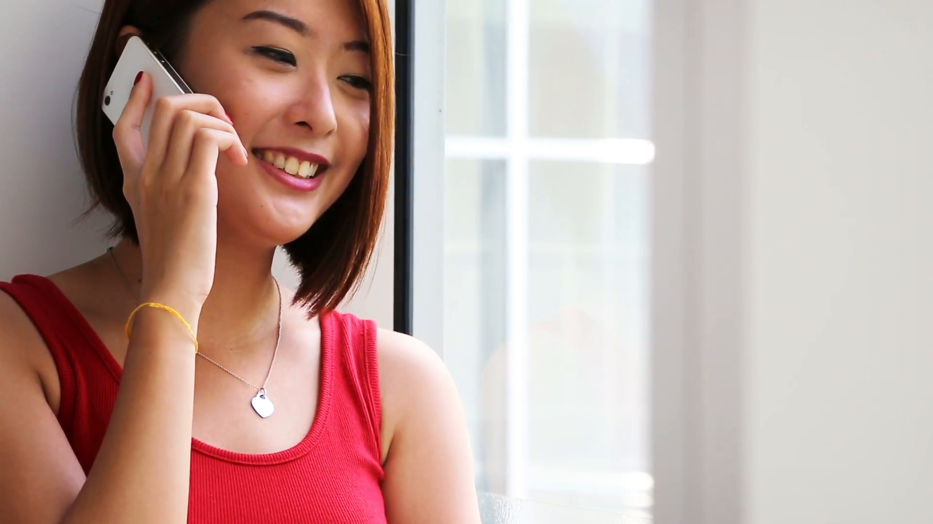 an-asian-young-lady-making-a-phone-call_nyarb0sq__F0000.png