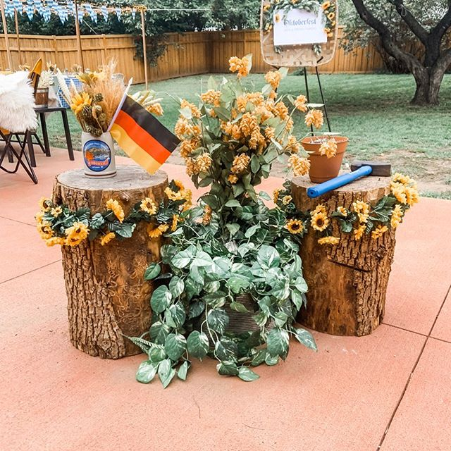 Every good Oktoberfest party needs a game of hammerschlagen! It's such a fun game that can involve everyone - I highly suggest wearing safety googles if, like me, you don't have the best aim 🤦‍♀️. I also say, why not spruce up a boring stump with some garlands and greenery for your Oktoberfest party. • • • #hammerschlagen #oktoberfestparty #partyplanner #partygames #germanparty #biergarten #partyideas #themeparty #diyitsfallohmy