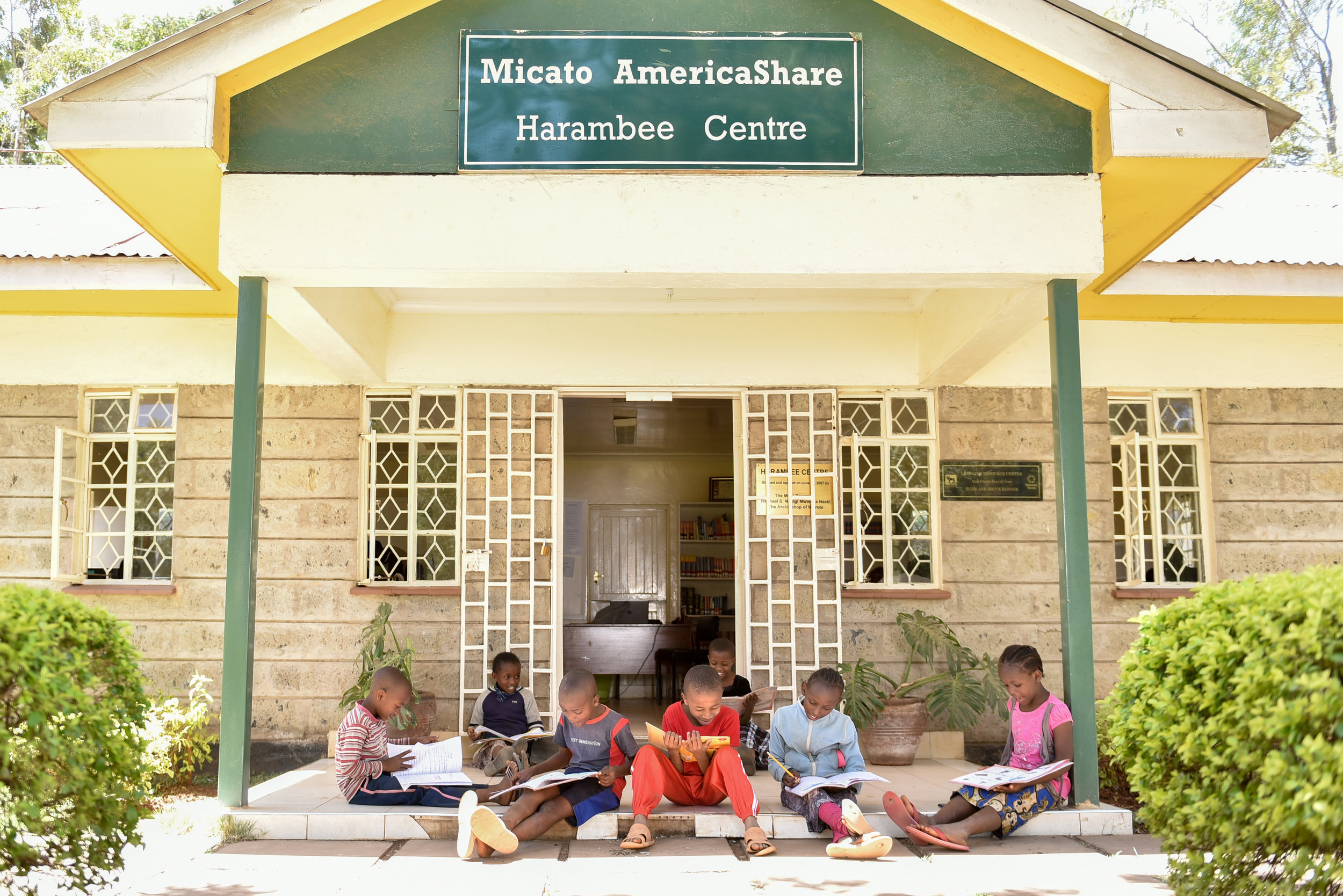 Mission and Vision - group of children in front of harambee center.jpg