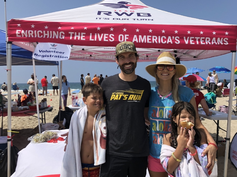 Our family volunteering at an RWB event teaching veterans how to surf.