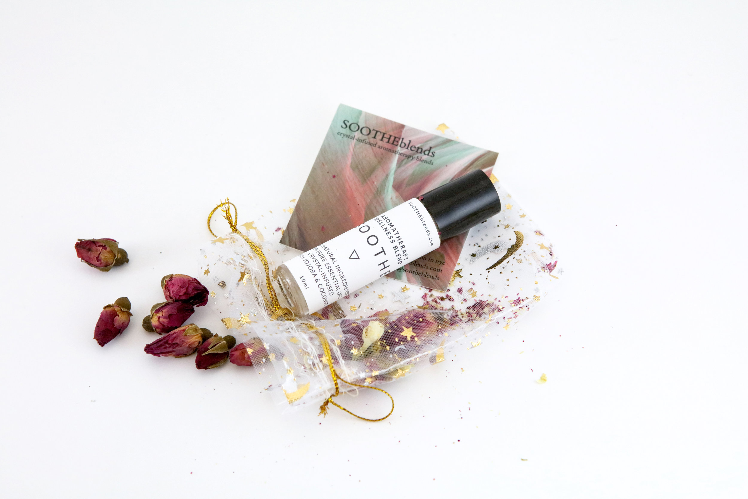 Therapeutic Item: SOOTHE Signature Aromatherapy Wellness Blend   SOOTHE is my signature blend. With notes of Chamomile, Lavender, Ginger, Peppermint & Eucalyptus, it both rejuvenates and calms, making it the perfect antidote to stress, muscular pain, and headaches while also remaining invigorating on the senses and, well, SOOTHing for the body & soul. A major component in all my blends is Jojoba oil, which is medicine for skin, hair, and nails. Each bottle of SOOTHE is infused with the healing properties of a particular crystal, which will be indicated within your package when it arrives. The alchemy of this specific blend relaxes, cools, and settles the nerves. Breathe SOOTHE in, and when you release your breath, stress & tension will go with it.