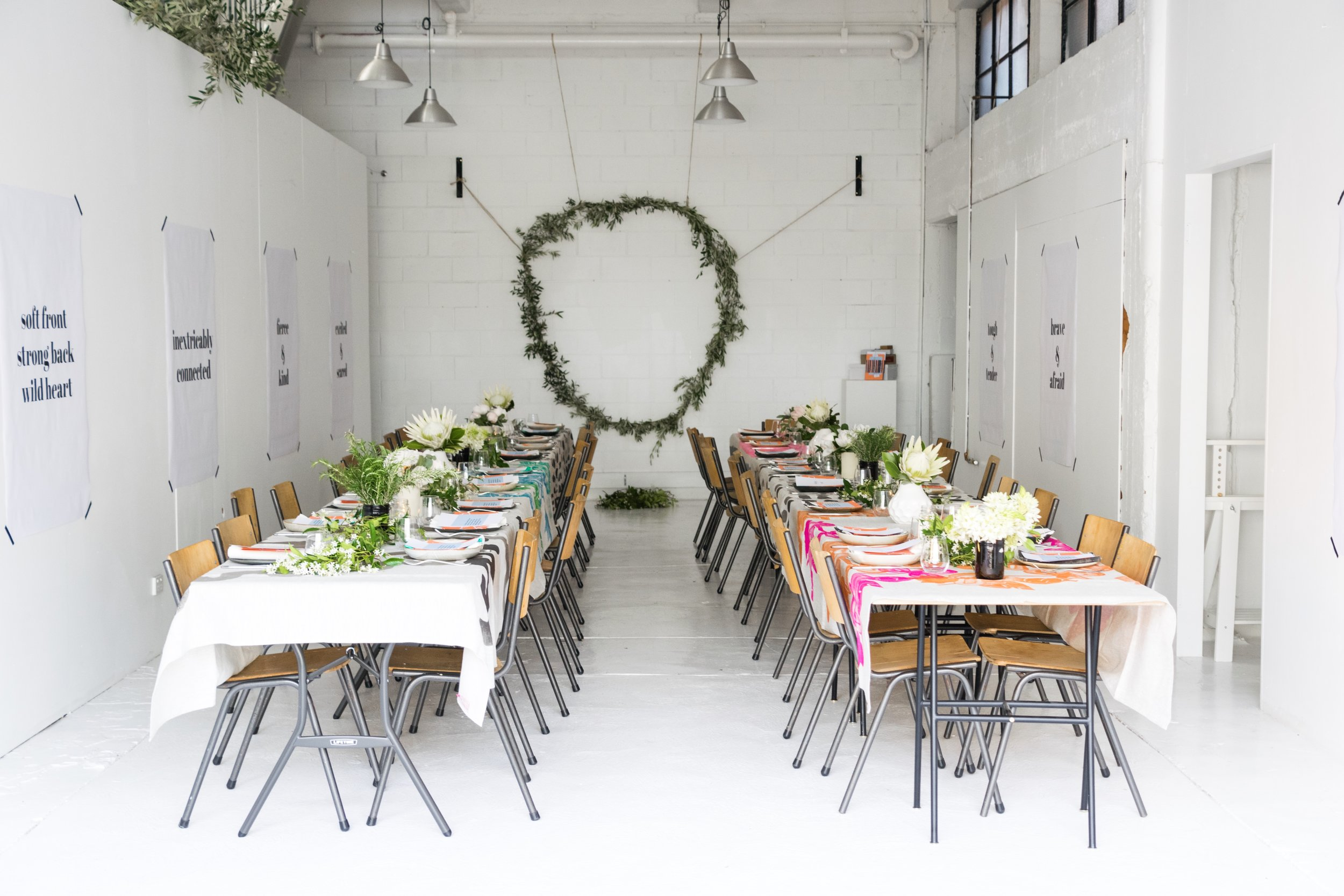 Bright, chic dining rooms set for 80 people for the Ofkin X Free to Feed Give Thanks Dinner.