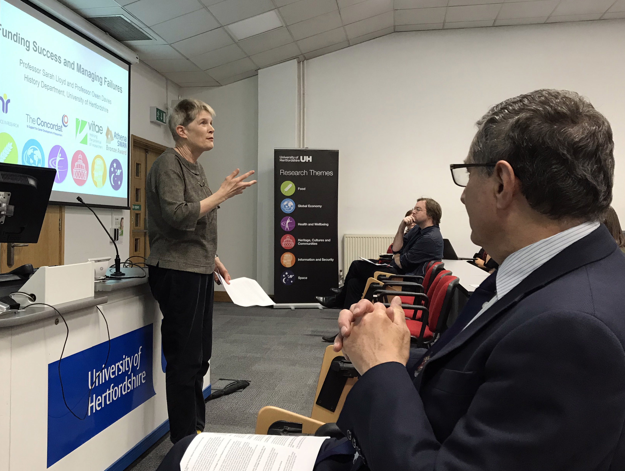 - Prof Sarah Lloyd discussing research funding successes and failures with Prof Owen Davies (centre) and Prof John Senior (right).