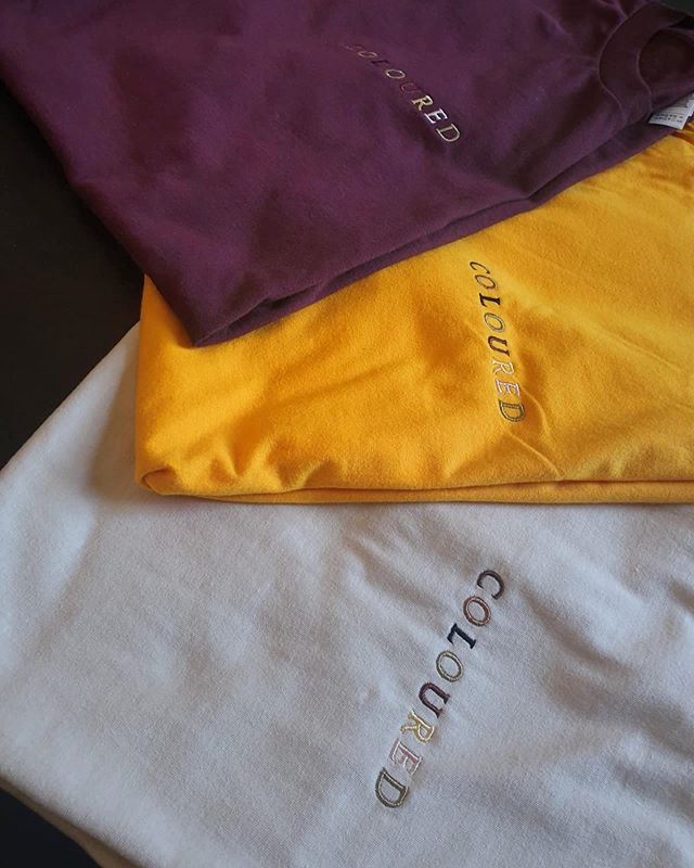"""3D Embroidered """"COLOURED"""" logo tee for an independent artist  1000 Seamless Stitches onto medium weight American Apparell jersey tees in an assortion of sizes and colours  Contact us to place your order"""