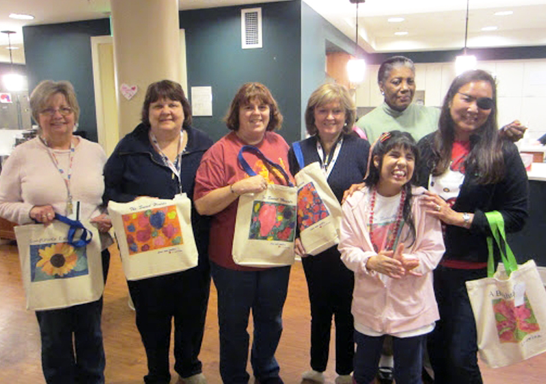 bro_Cancer patients holding ABW bags with Cristina smalLIGHTERl.jpg