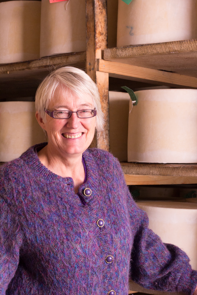 Mary of Quicke's Cheese posing with her wheels