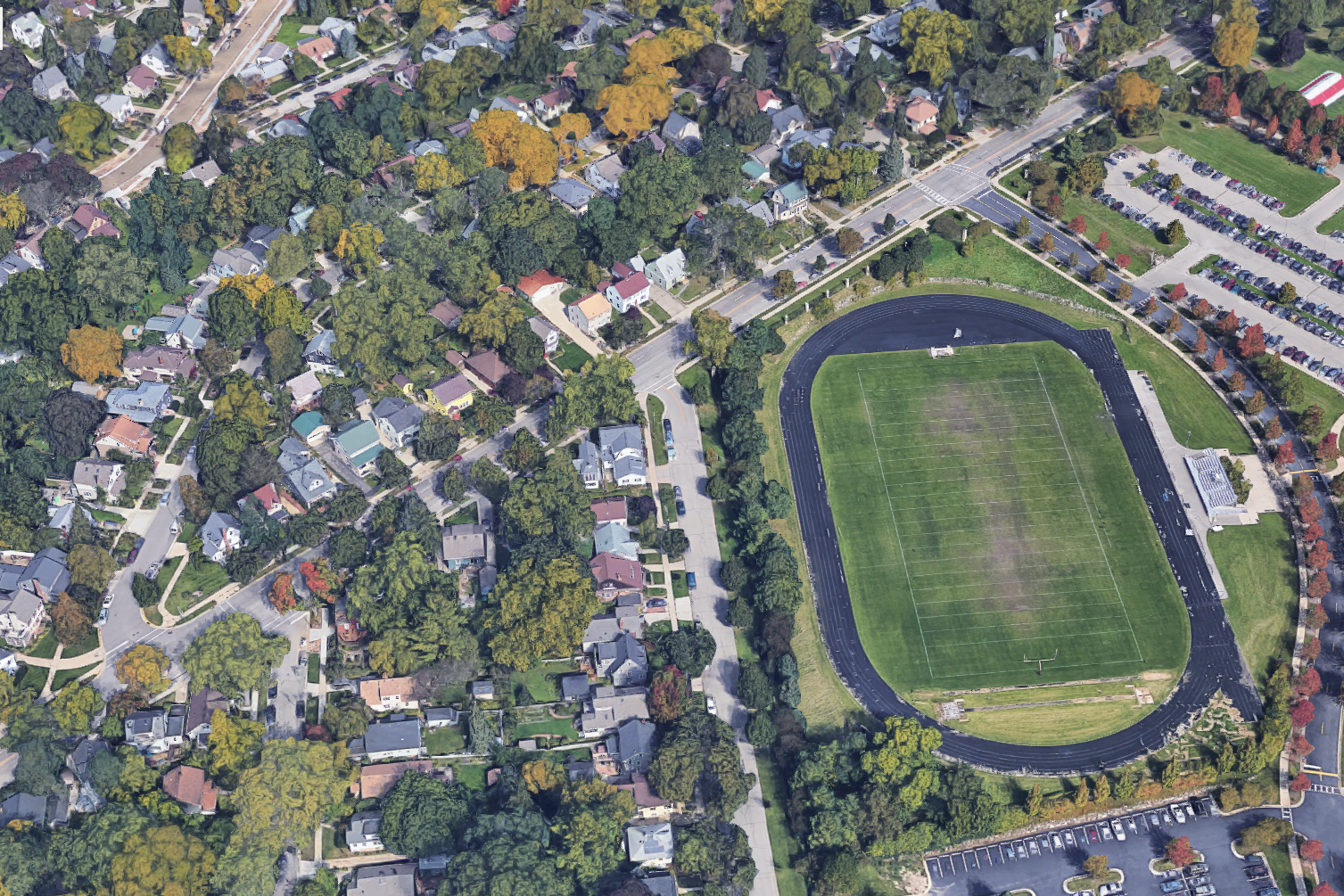 The proposed stadium is closer to neighborhood homes than it is to the school building. Edgewood High School is to the right of the field—out of the frame of this image.