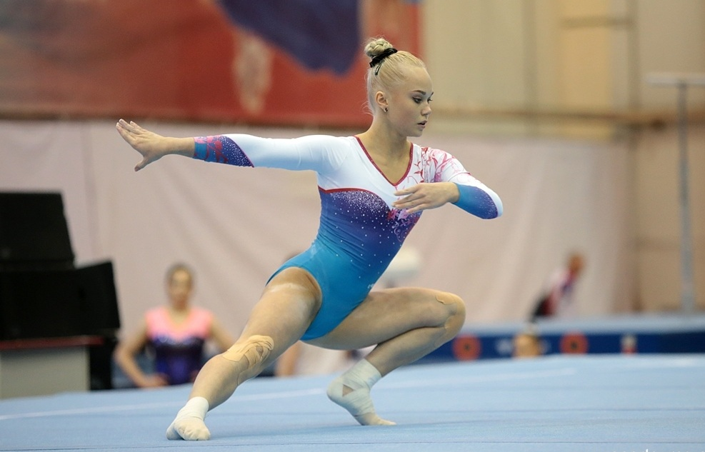 Angelina Melnikova on floor.