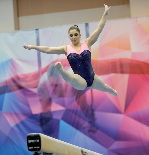 Aliya Mustafina on beam.