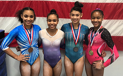 Left to right, Sydney Barros, Konnor McClain, Kayla DiCello and Skye Blakely. Photo: USA Gymnastics.