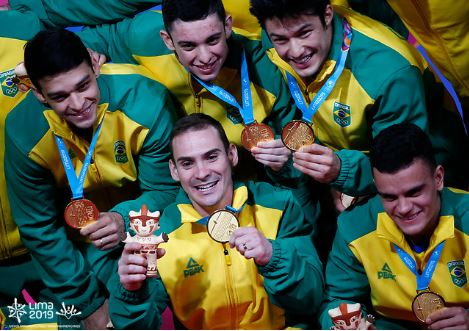 Clockwise, from top left: Francisco Barretto, Luis Porto, Arthur Nory, Caio Souza and Arthur Zanetti celebrate Brazil's second ever team gold at the Pan American Games. Photo: Marcos Brindicci/Lima 2019.