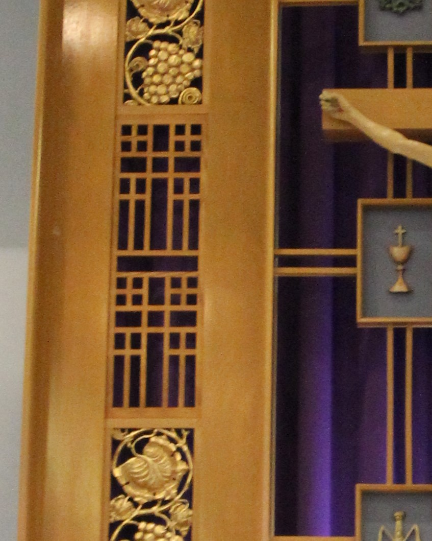 Reredos up close - Notice the cross pattern and how it is replicated in the woodwork of the sanctuary walls.