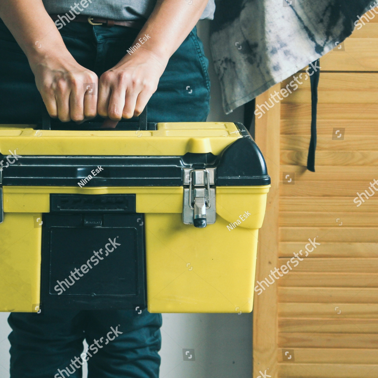 stock-photo-woman-holding-a-toolbox-1177003720.jpg