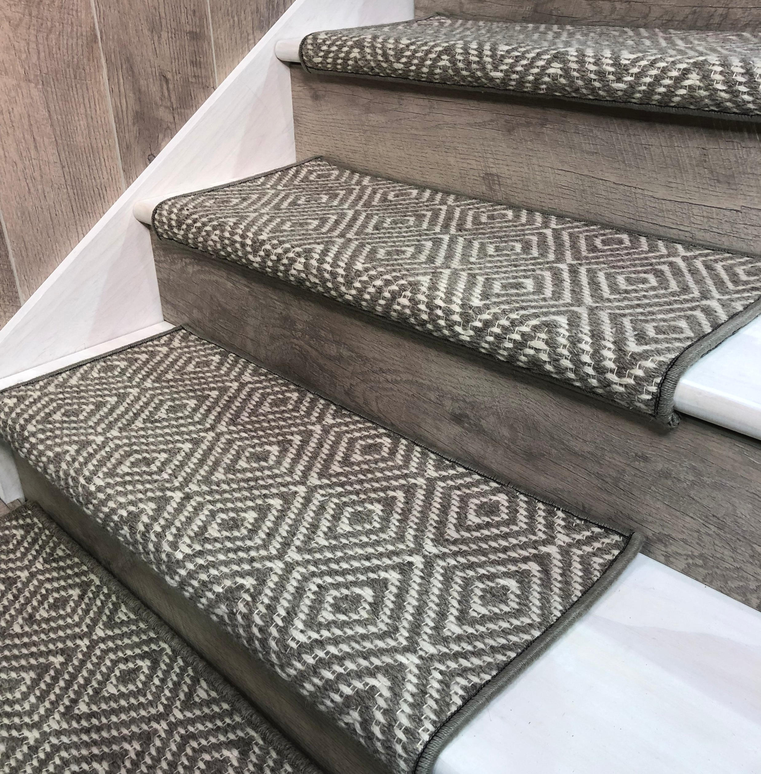 """Bullnose ROUND EDGE stair tread shown in Grey """"TAHOE"""" by J MISH."""