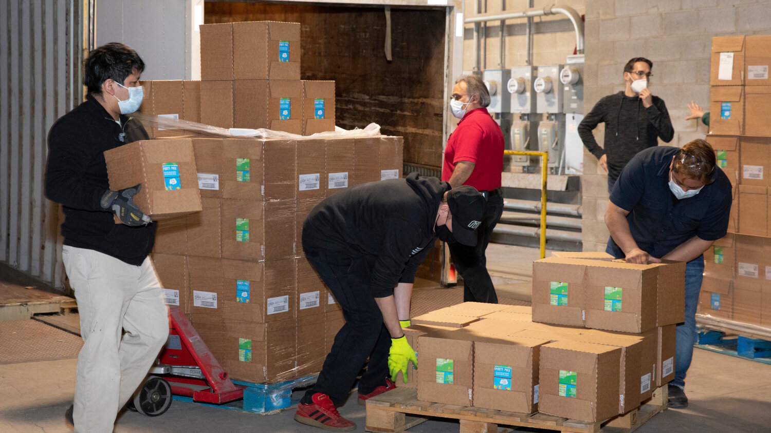 Workers load food supplies into a Mid-West Moving & Storage Vehicle. The company is one of more than 1,000 that help Move For Hunger transport needed food to food banks around the nation. (Photo: Move For Hunger)