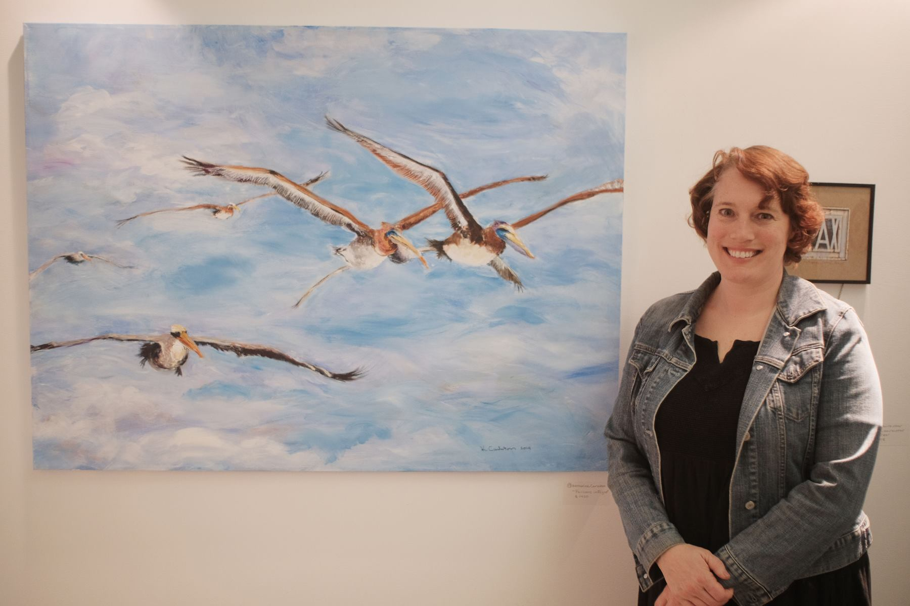 "First Place (Tie)  Katherine H. Carleton with ""Pelicans in Flight."""