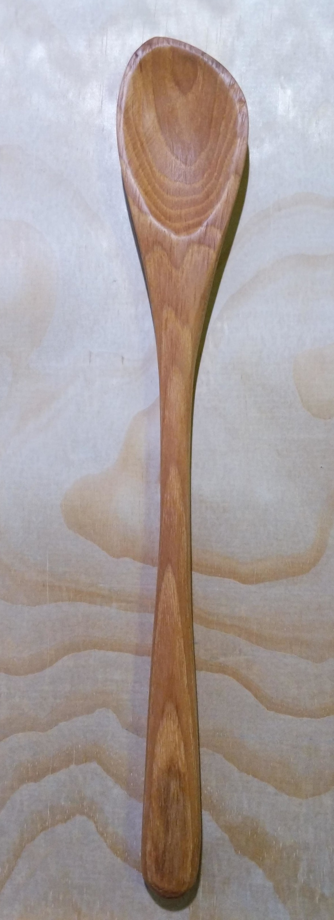 "Curved spoon, hickory, left handed, 12.5"" long"