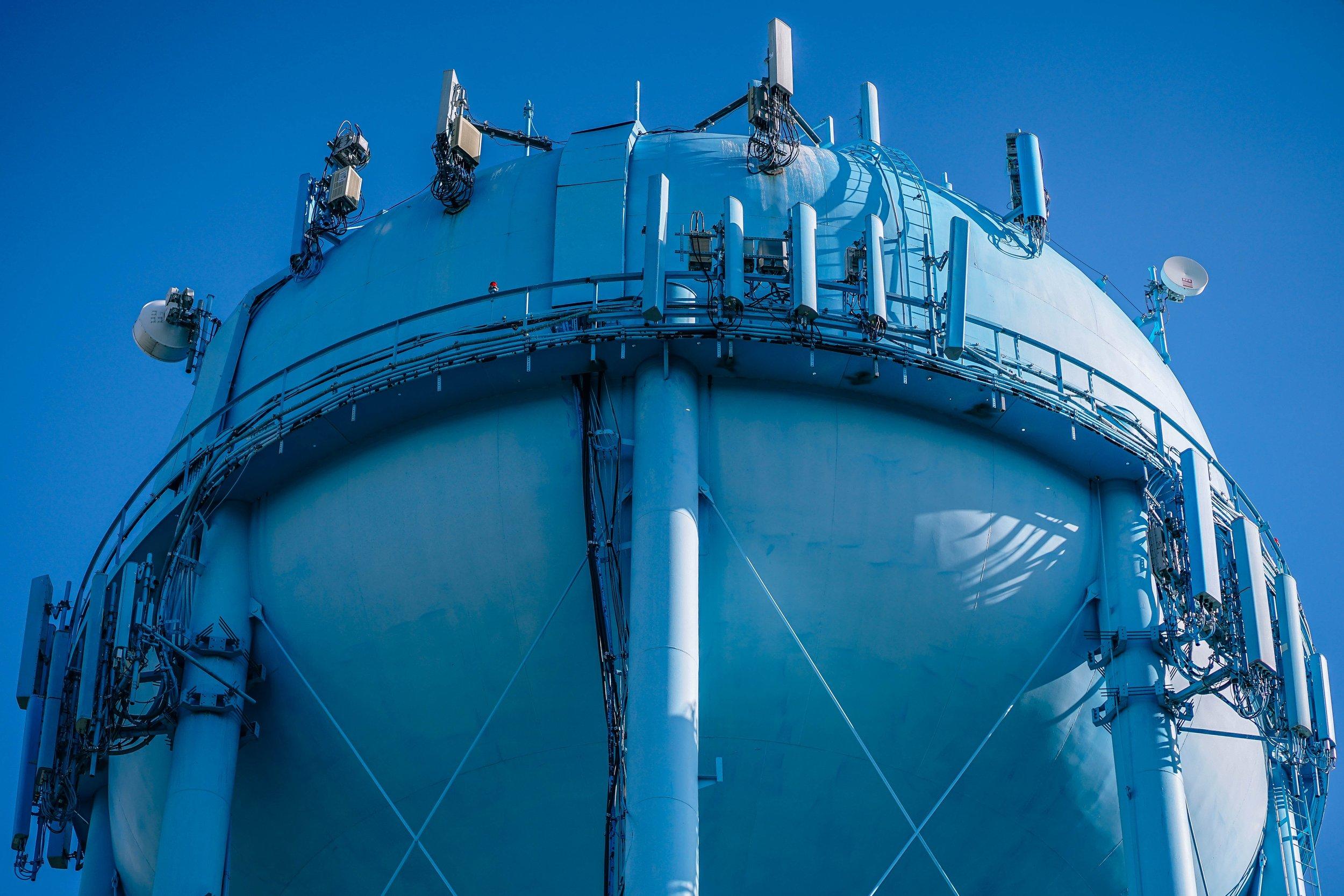 blue water tower stock photo - unsplash.jpg