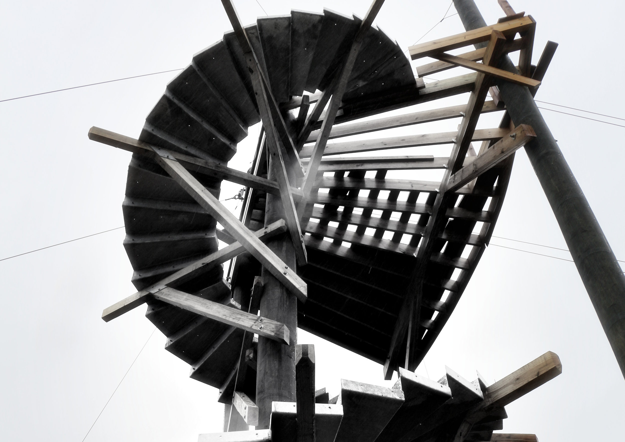 Spiral stair design being brought to life on a zipline tour launch tower.