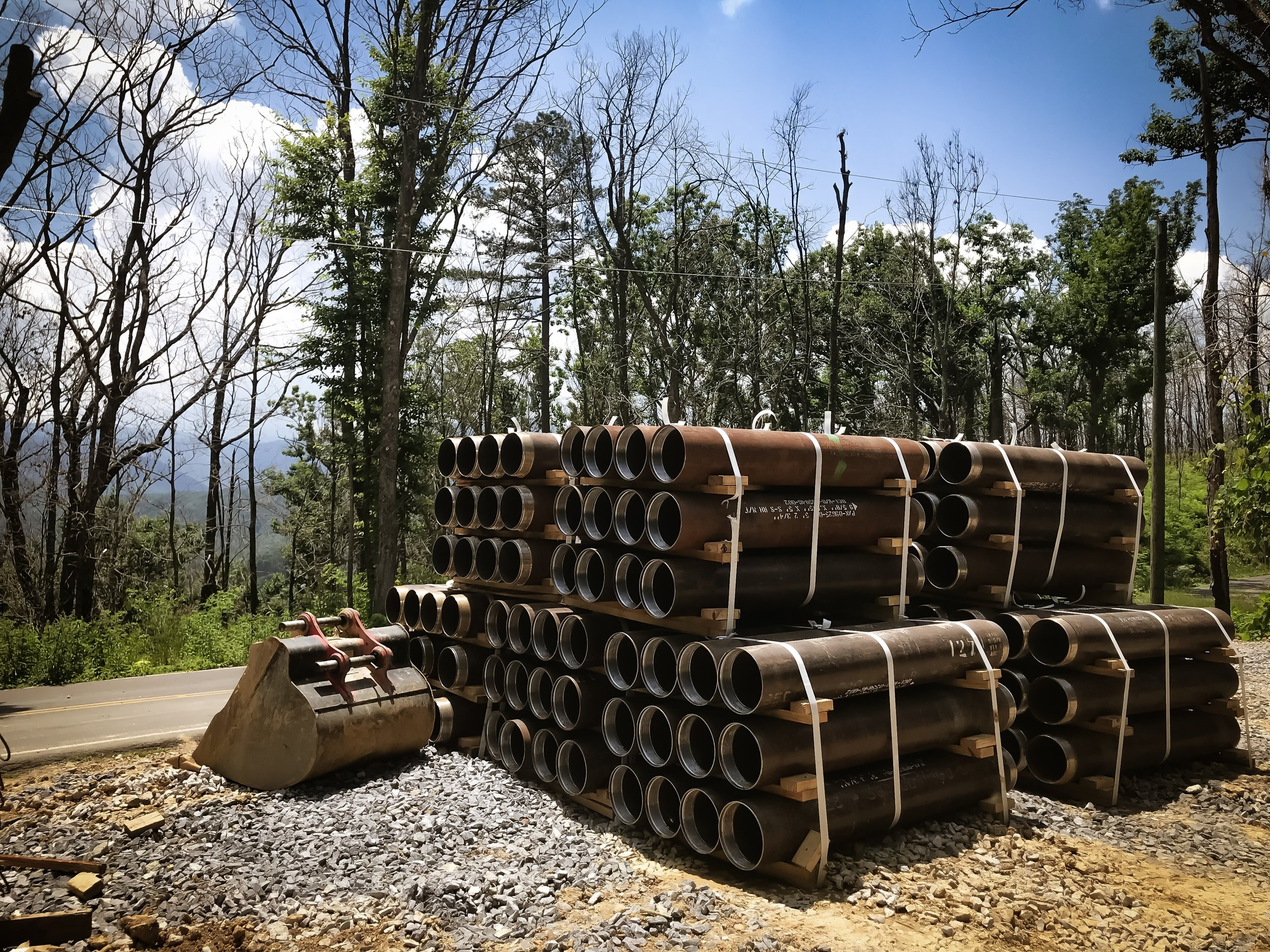 Some steel micropile casings in the lay down area in Gatlinburg, waiting to be put to use.