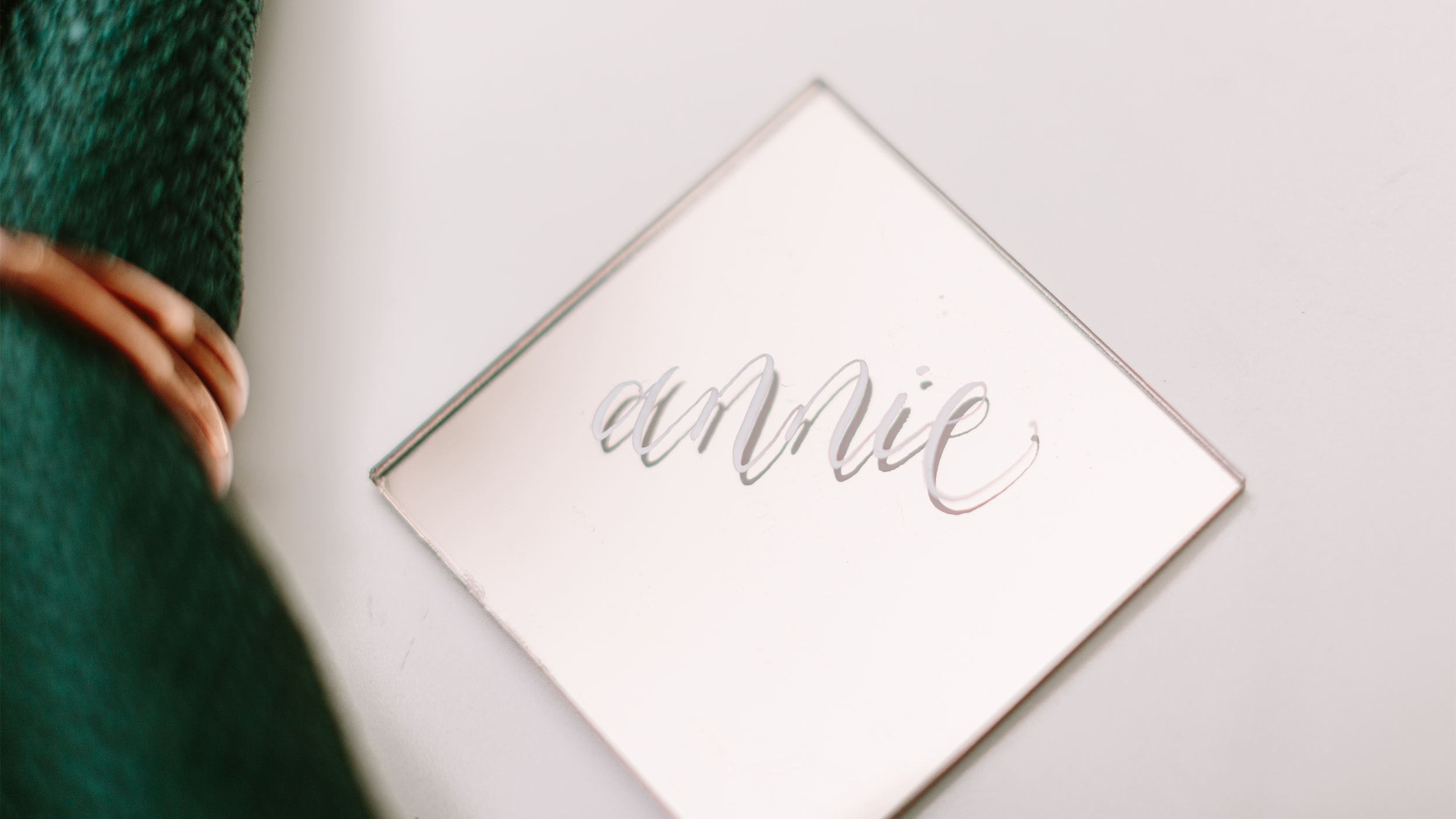 gold mirrored acrylic place card calligraphy