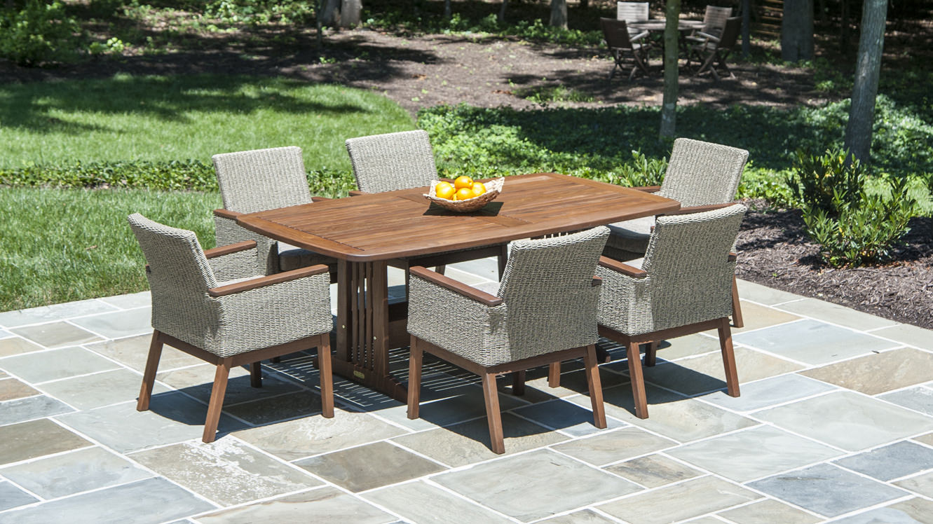 Outdoor Dining for 6 with weather resistant Ipe wood Belmont dining table and Coral dining chairs made of ultra durable resin wicker with Ipe wood arms & frames. Low maintenance & easy care makes this furniture easy to own.