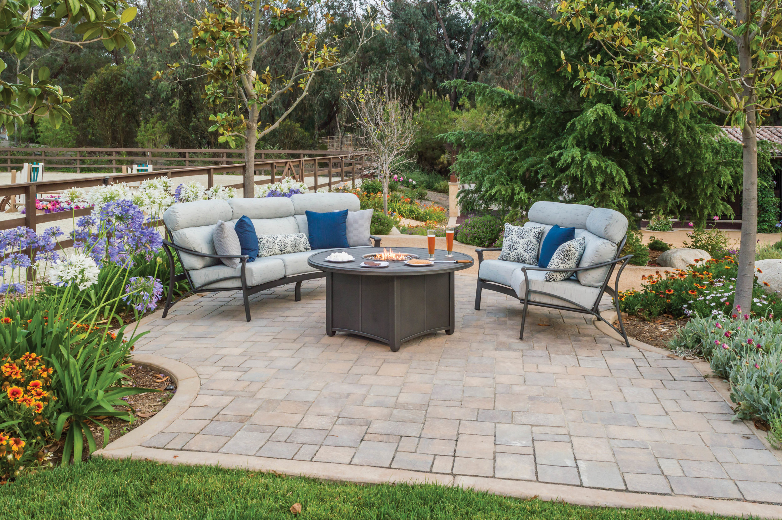 Corsica cushion sofa and loveseat with powder coated aluminum frame and propane cast aluminum firepit. The ultimate in outdoor casual enteraining and dining.
