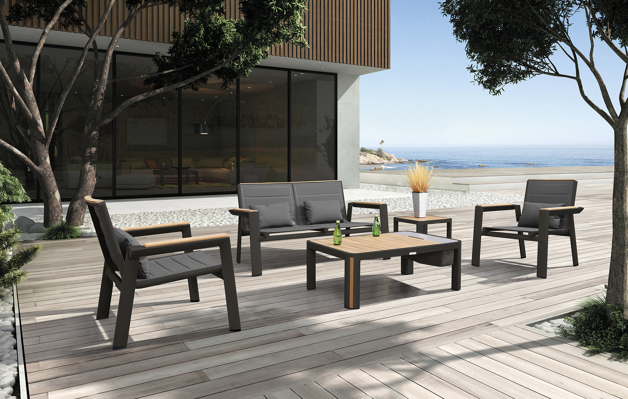 The Geneva Collections combines the contemporary clean lines of crisp powder coated aluminum with fine quality warm teak wood inserts and accents to create beautiful stylish furniture. The furniture is uniquely comfortable resulting from the use of padded textilene in the chairs and loungers. Two Geneva lounge chairs, Geneva loveseat and Geneva coffee table with built in ice bucket.