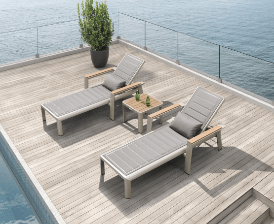 Geneva contemporary sun lounger and teak top side table. Quick drying padded fabric is practical and comfortable. Perfect for lazing away a summer afternoon.