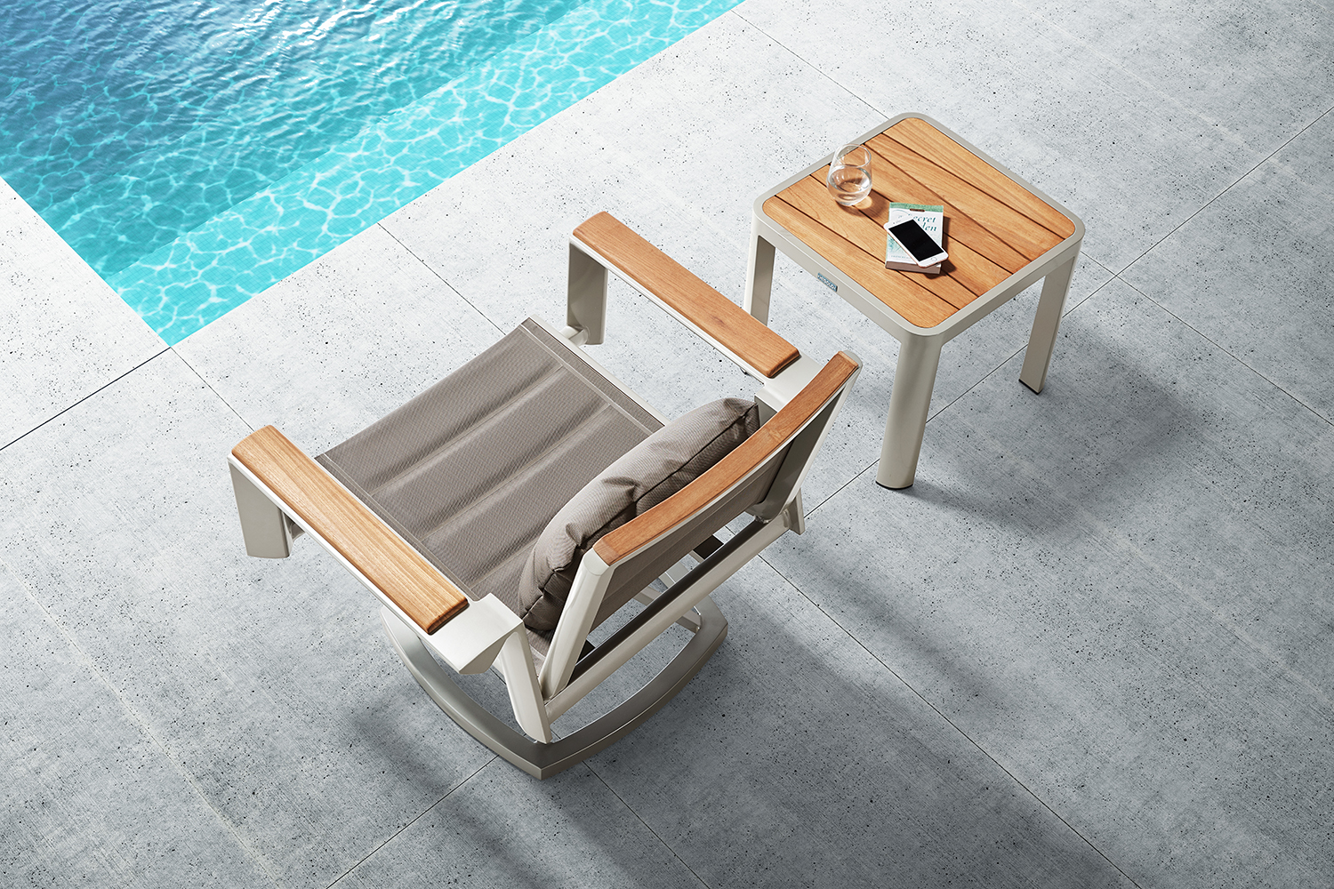 Geneva contemporary swivel rocker lounge chair and teak top side table are perfect for any small area. Padded fabric provides comfort yet is quick drying.