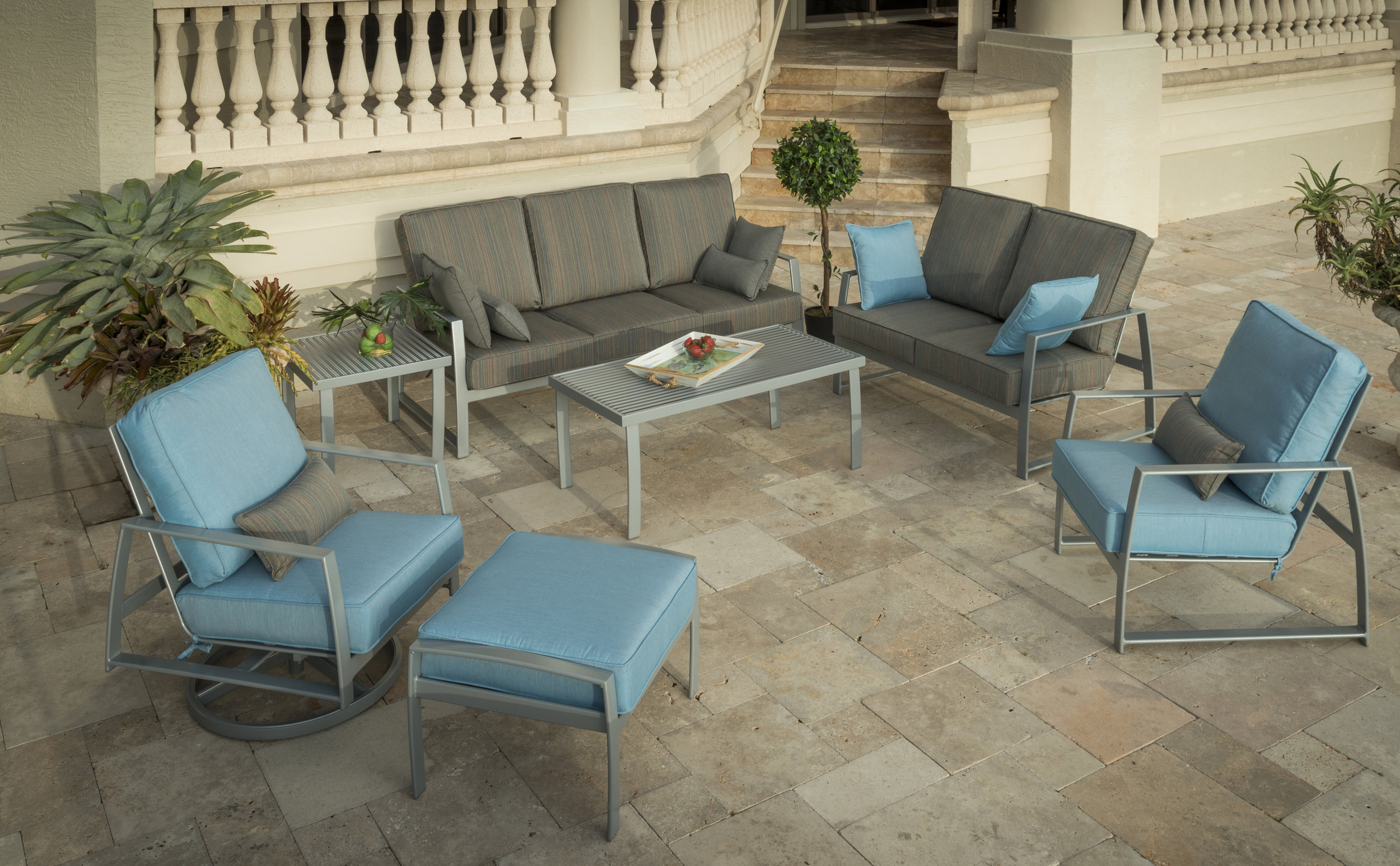 Krisp deep seating powder coated aluminum frame sofa, loveseat, swivel action lounge chair, lounge chair and ottoman. Boardwalk aluminum coffee and side tables.