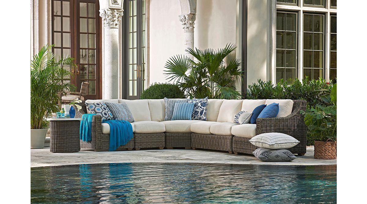 Understated and refined outdoor spaces are effortless with the Oasis Sectional Collection.