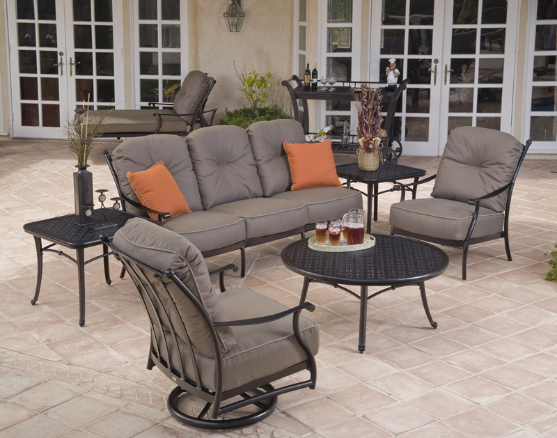 Seville Collection sofa, swivel rocker lounge chair and lounge chair with Napa coffee table and end table.