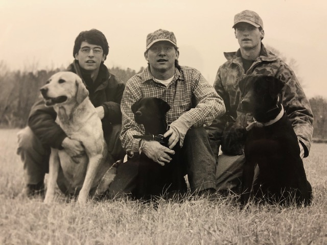 Chip and Ole Miss classmates with their beloved dogs