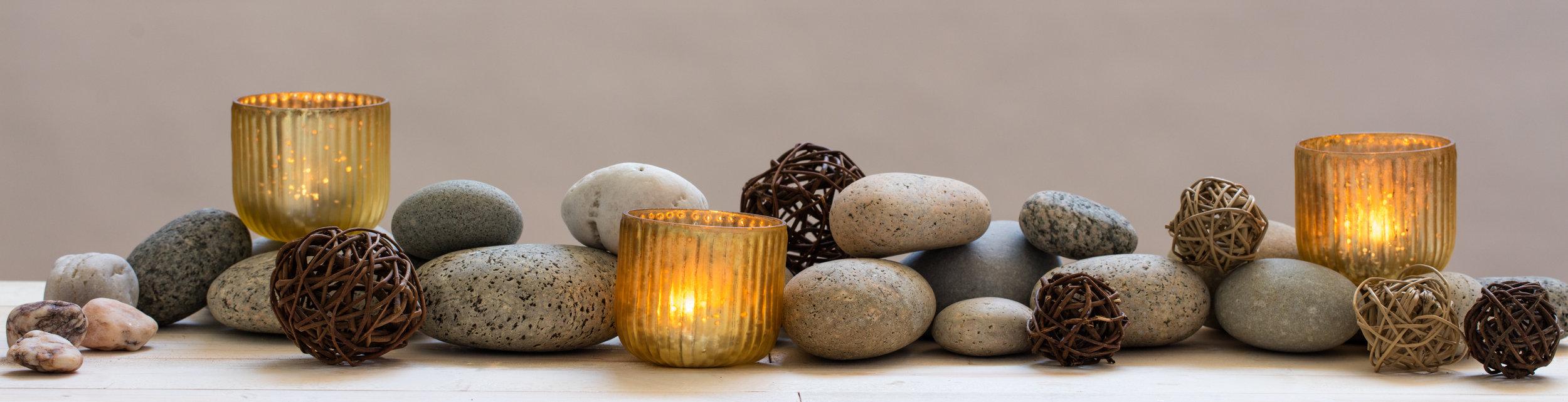 AdobeStock pd_170849253 - horiz stones and candles.jpeg