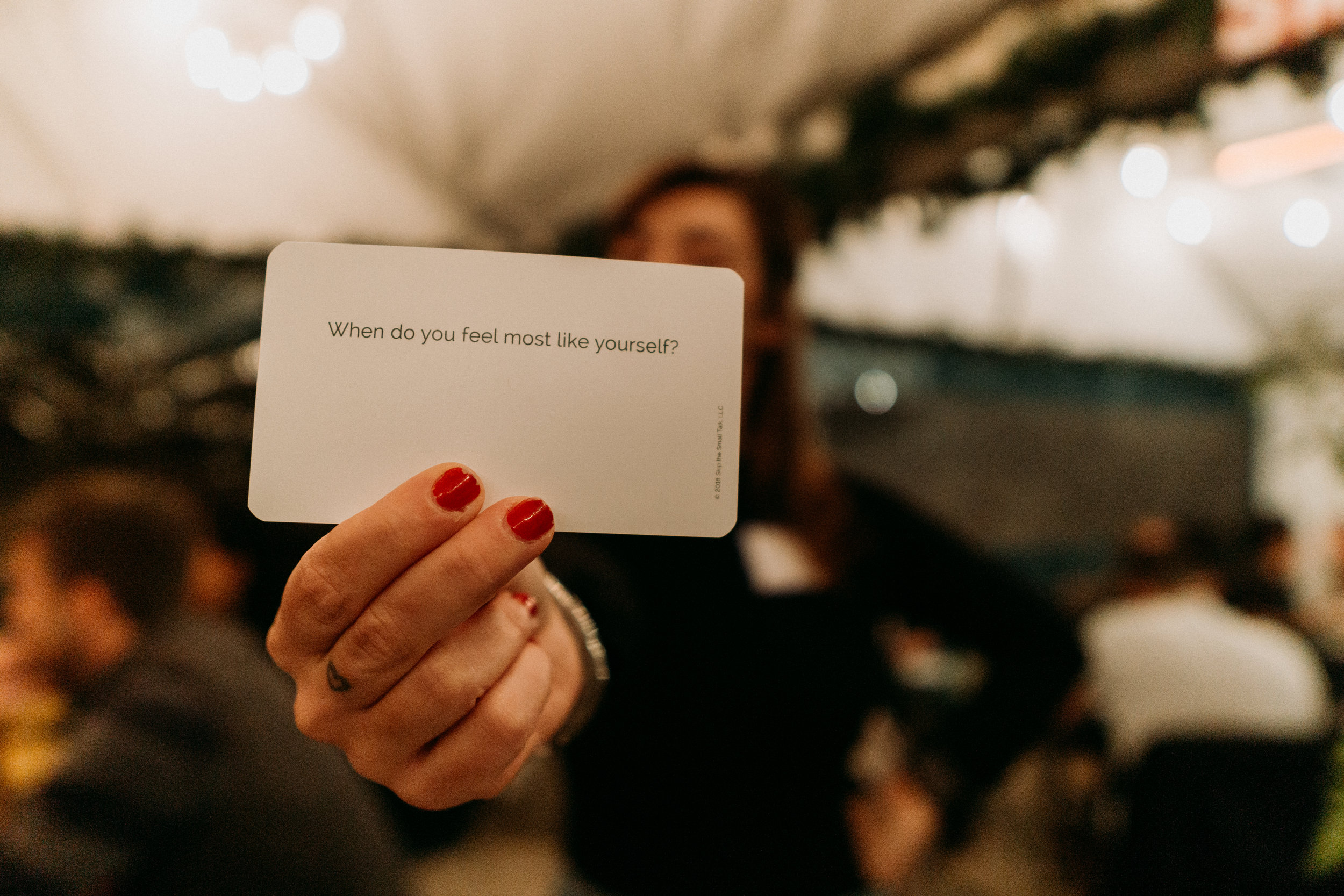 Question cards written by Ashley Kirsner give prompts for participants to delve into more personal questions they wouldn't typically ask someone they just met.
