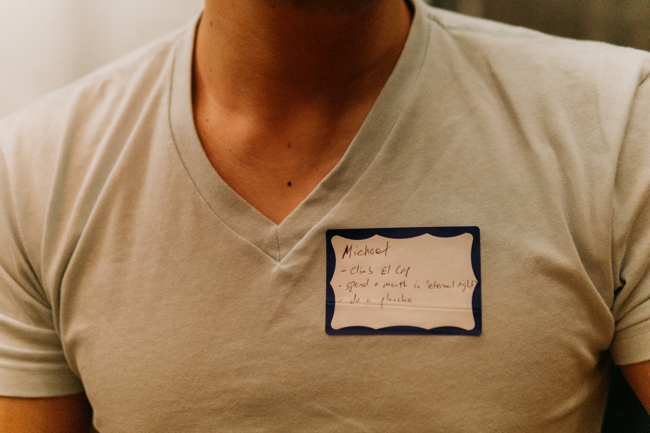"""To break the ice, participants are asked to write three things from their bucket list on their name tag. Michael's """"climb El Cap"""" """"spend a month in 'eternal night'"""" and """"do a planche"""" are just some examples of the amazing things Brooklynites want to do before they die."""