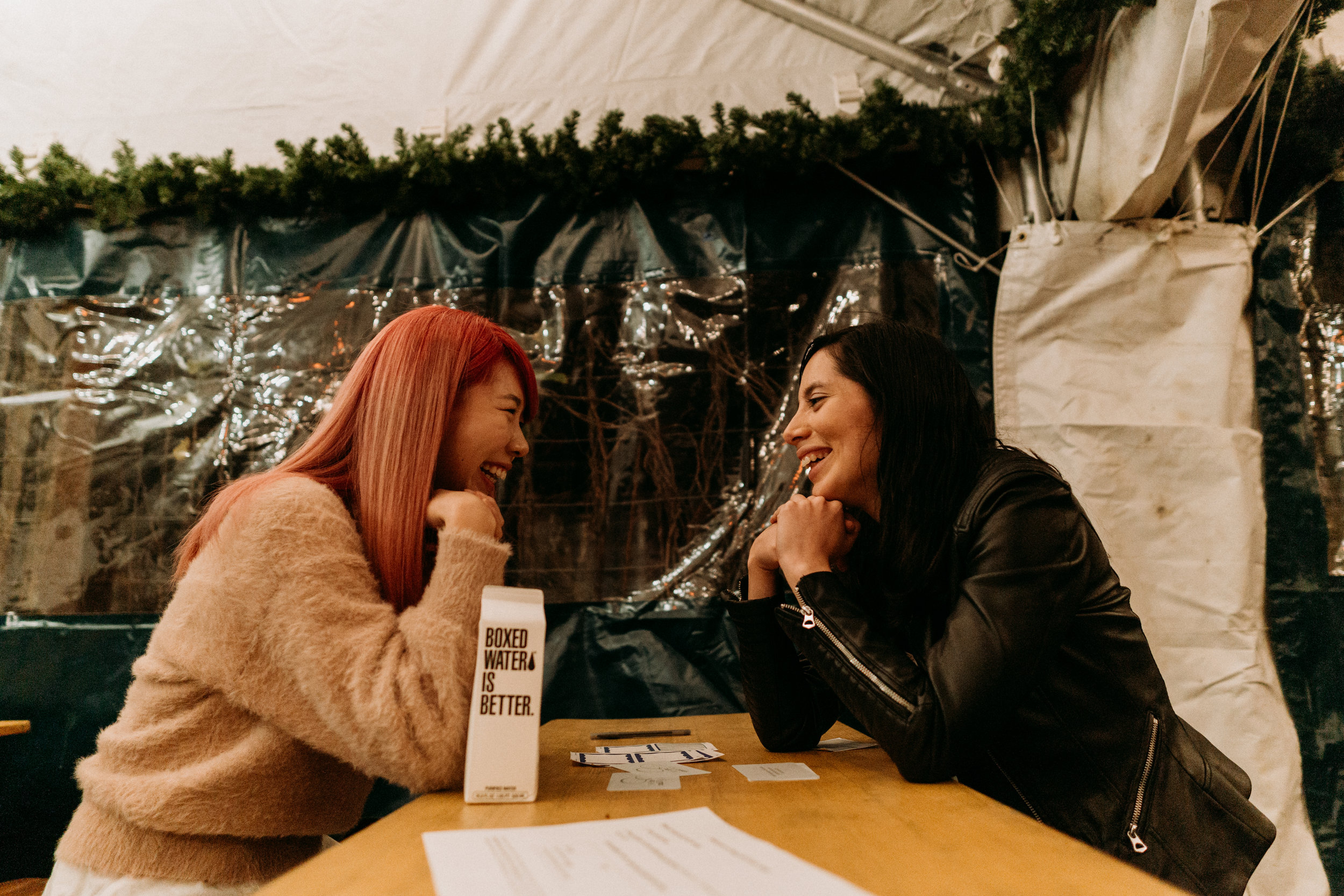 Two participants share a laugh during one of the rounds of Skip The Small Talk. Although most of the questions are serious, there's no lack of a sense of humor sharing things about your life.