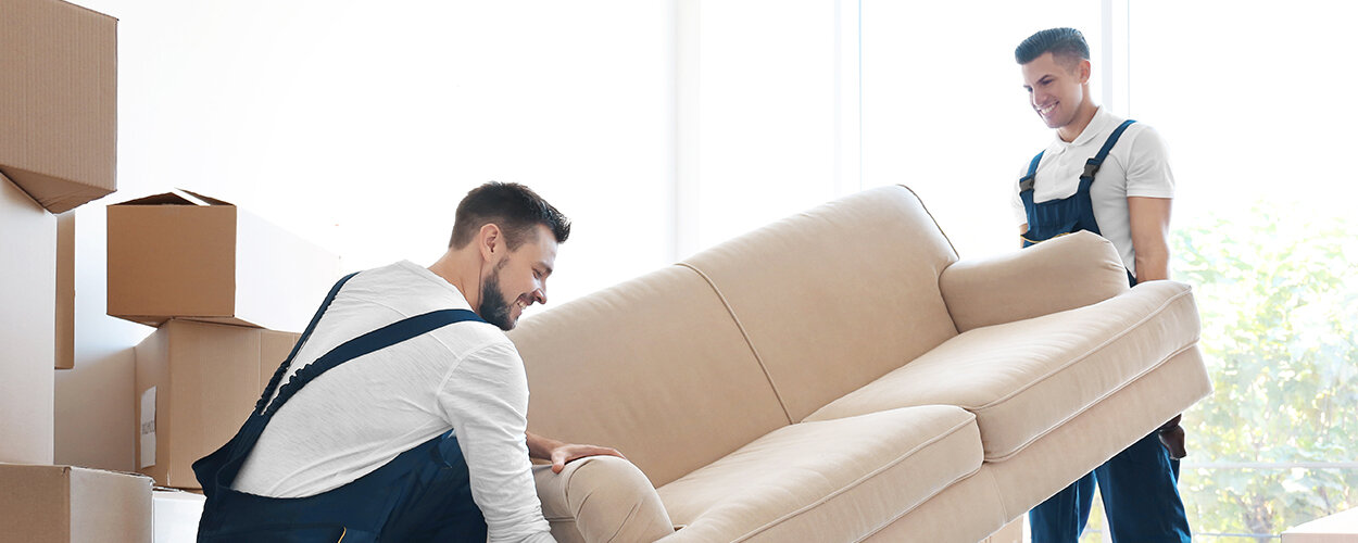 Two men carrying couch