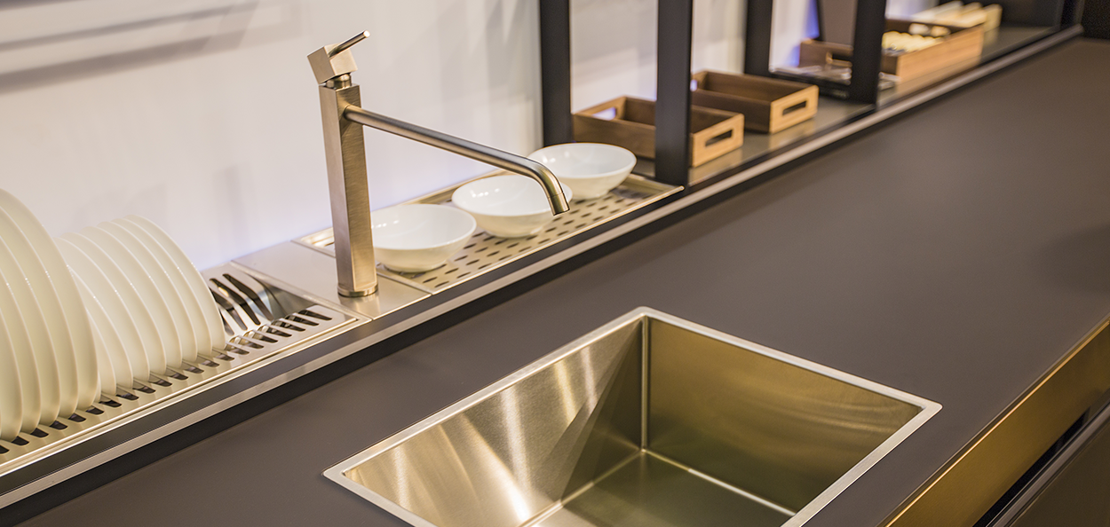 Gold kitchen sink and tap