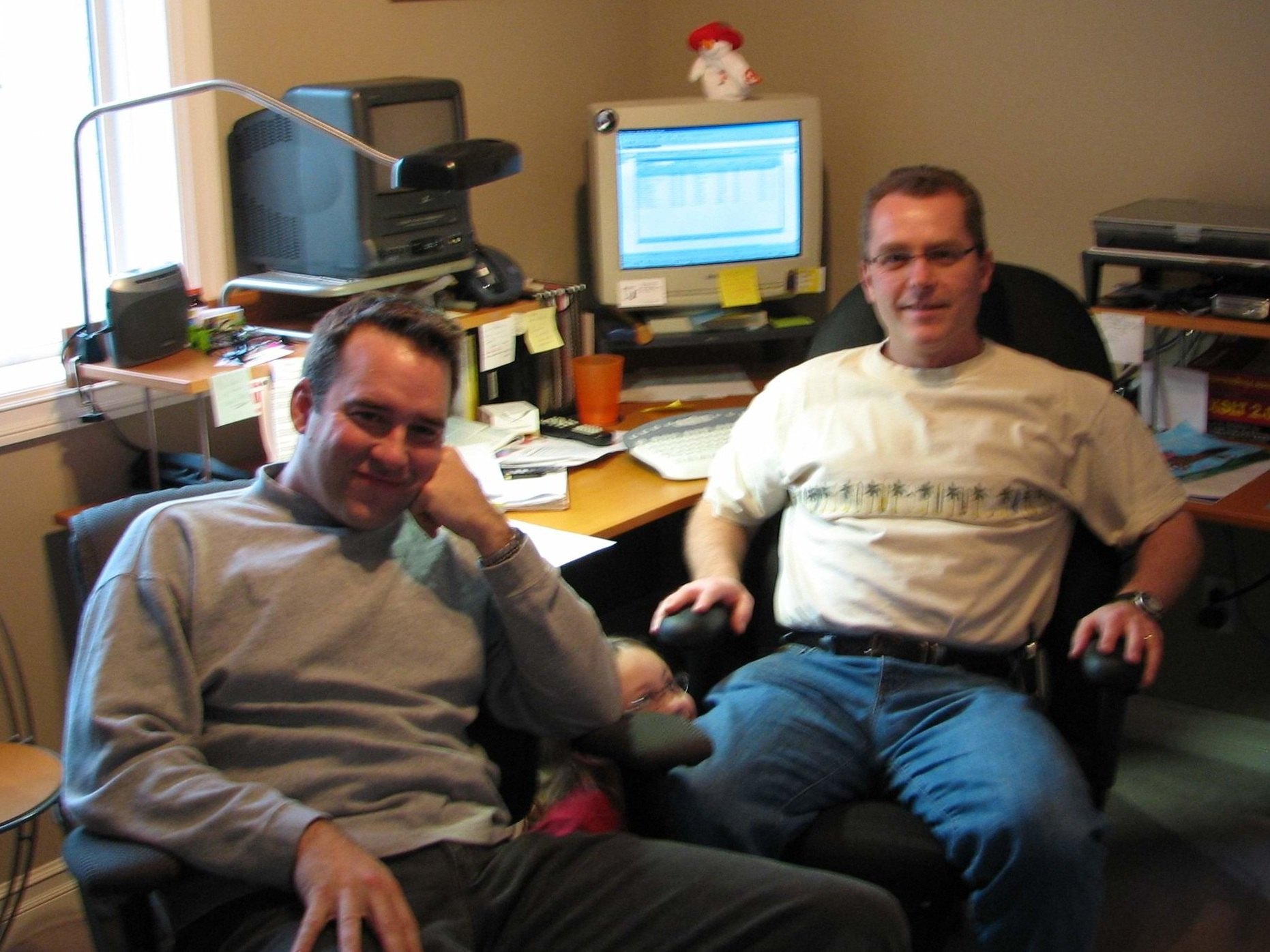 Chris and Kevin at one of their earlier RI offices.