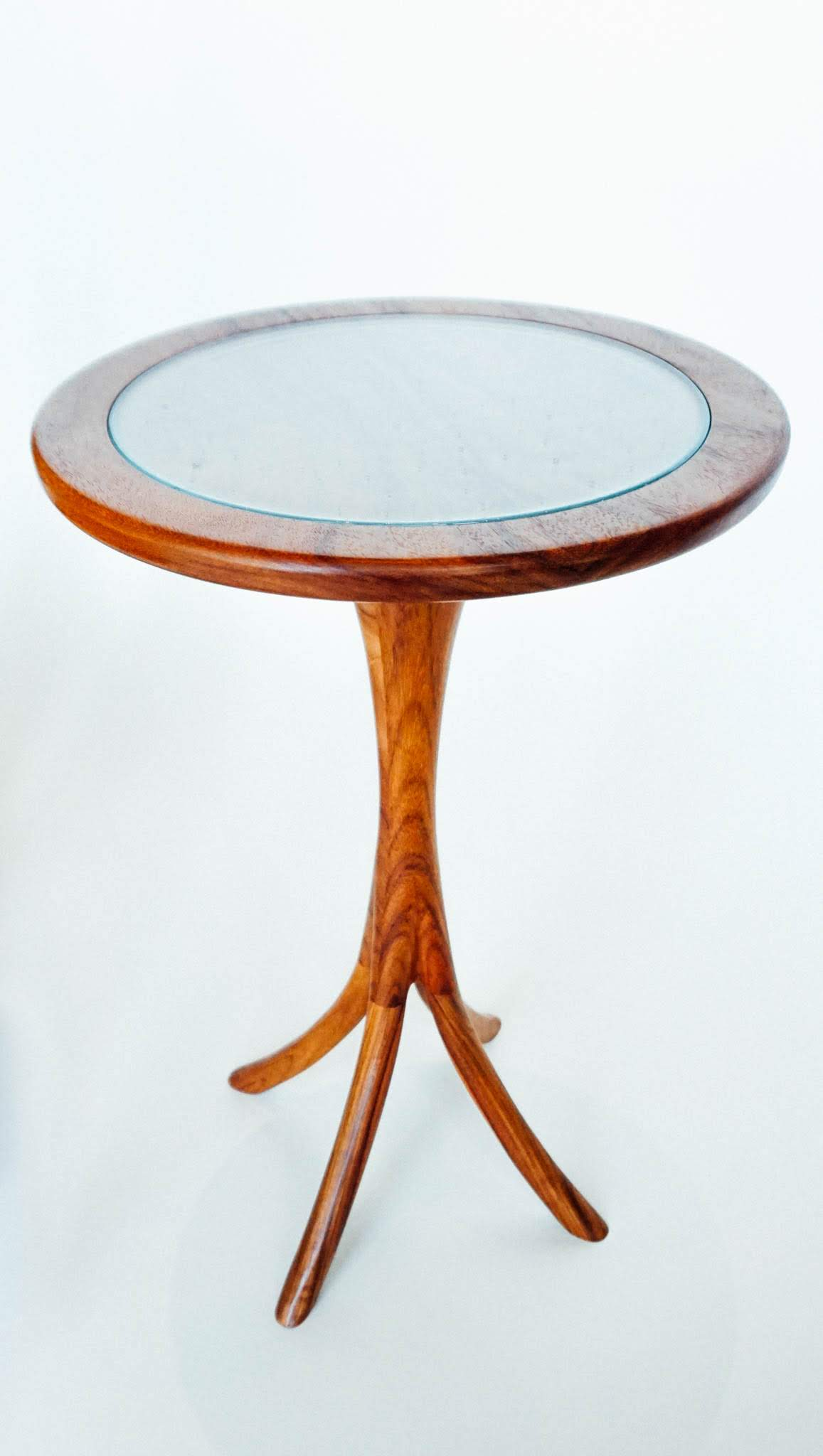 """The table is approximately 22"""" tall and 14"""" in diameter and shown in macawood. It is perfect for a cuppa of whatever suits you. The custom made glass top provides visibility to the wood's beauty and an attractive cover to prevent damage to the finish. It is the perfect complement to your new chair."""