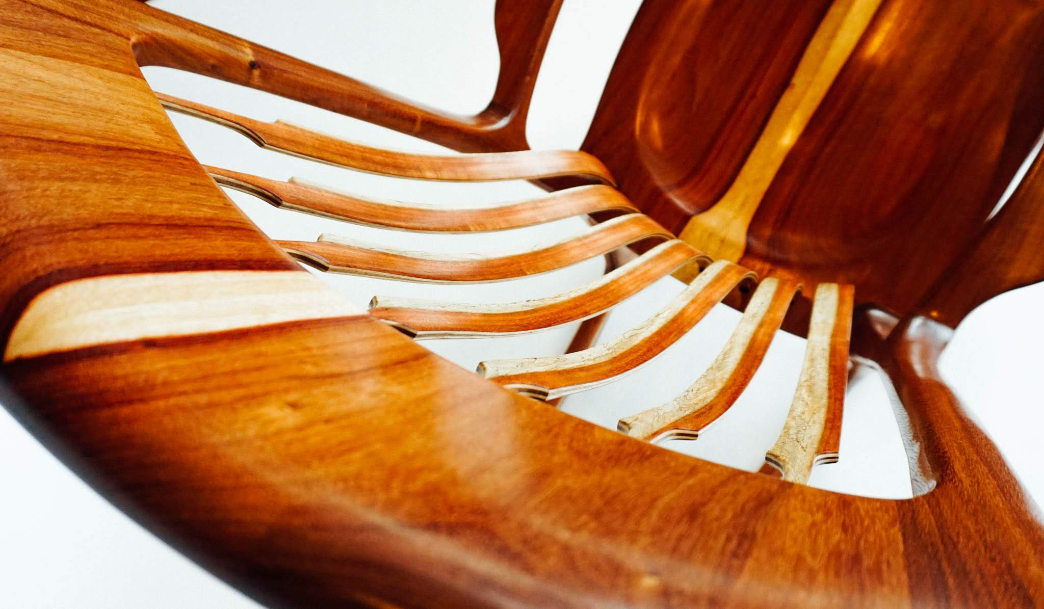 This photo highlights the sapwood detail in the headrest,  back braces and seat.  All the wood is carefully grain matched for beautiful symmetry.