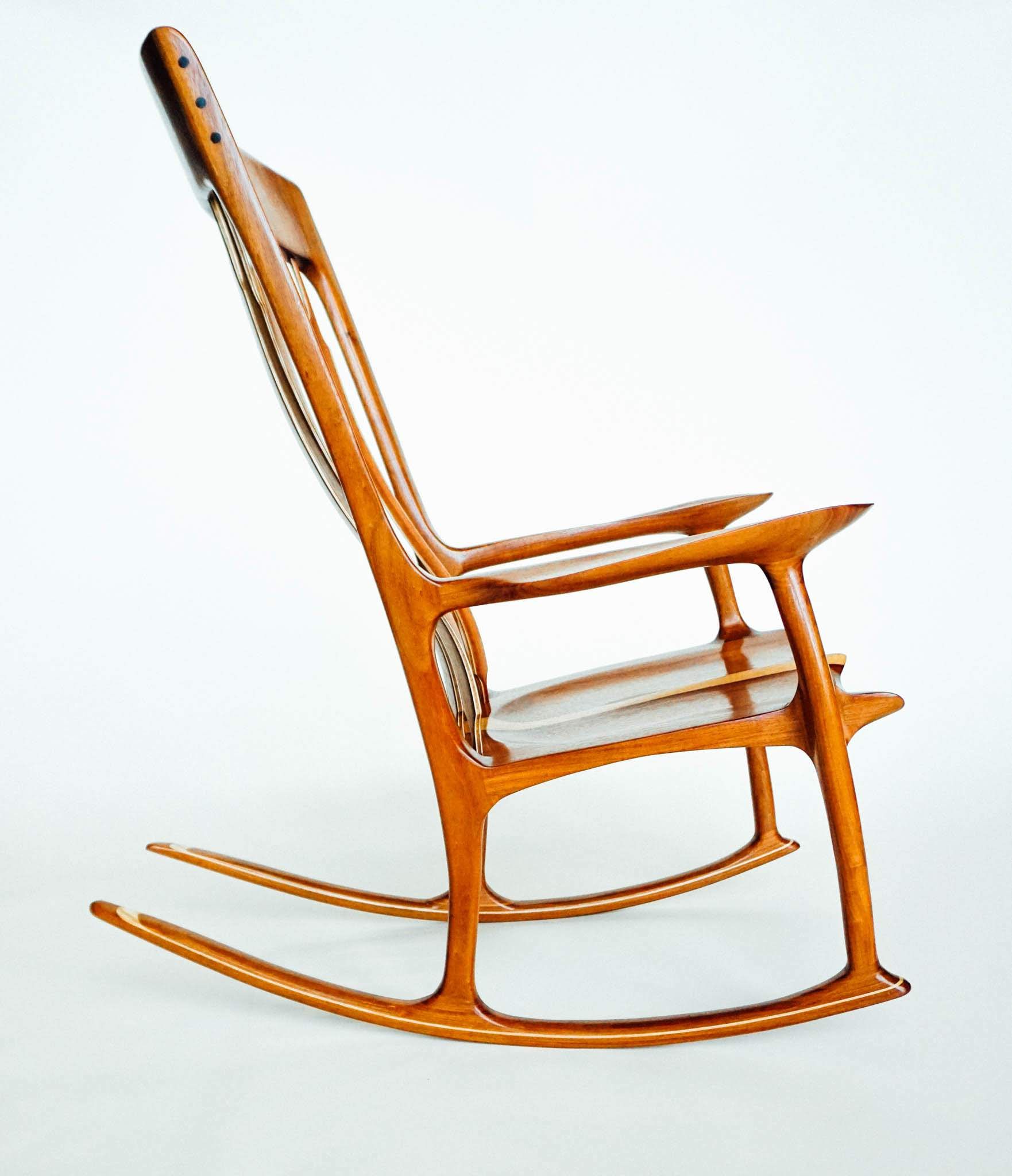 Profile of macawood chair. Note the ebony plugs for the headrest and the shallow curve in the underside of the seat.