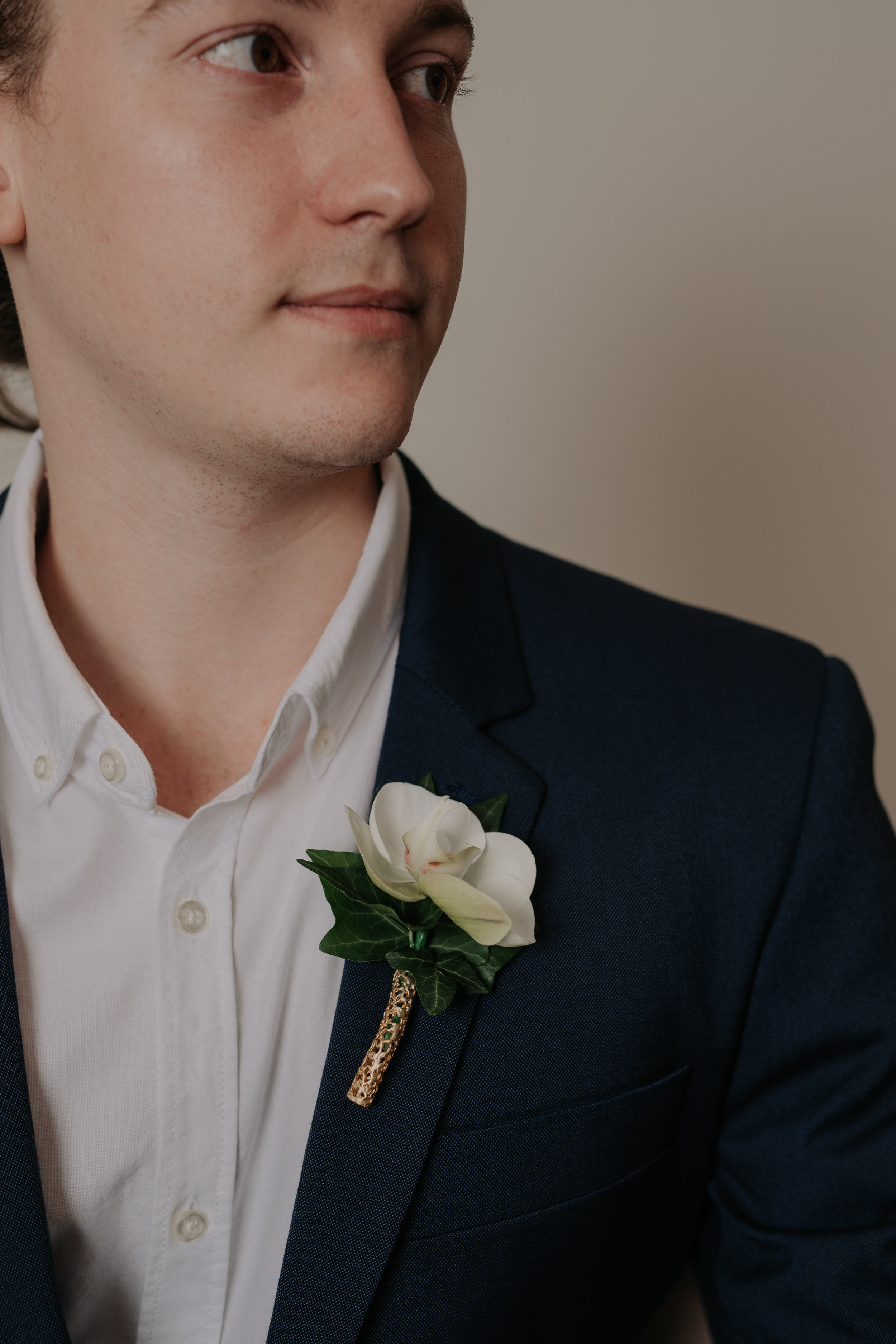 This is Jackson… - Umm… no, not the guy, his name is Tarik.I was talking about the Gold Filigree Boutonnière Pin he's wearing on his lapel.Jackson is part of our new gender neutral collection. Coming to Loving Soon!Want to hear more about Jackson?Sign up to receive regular Love Letters straight to your inbox!