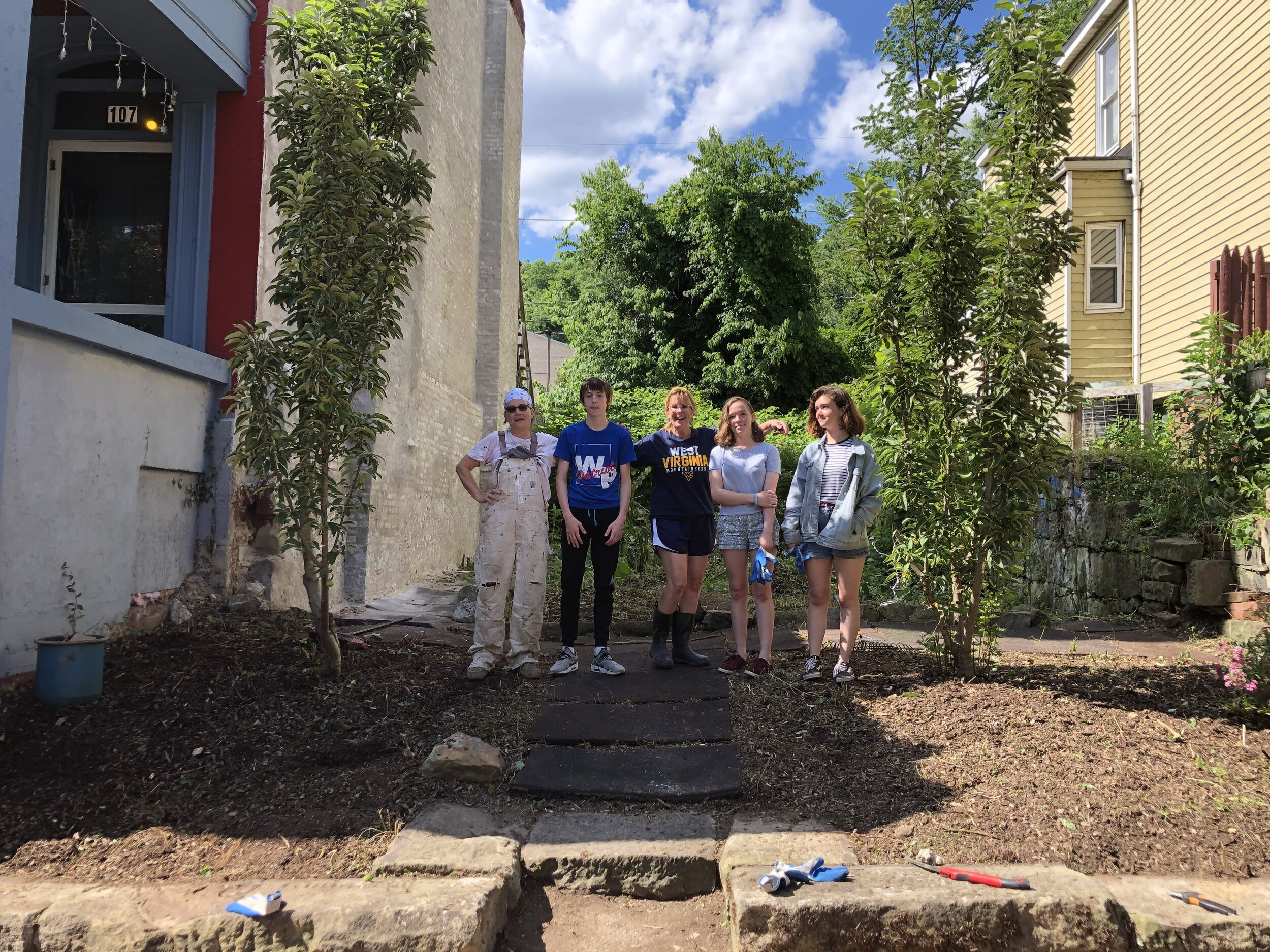 Beautiful neighborhoods matter to street moms. Some youth in the neighborhood volunteered to help.